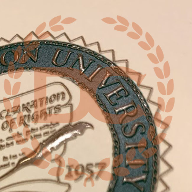 fully embossed gold and full seal on a fake George Mason university diploma