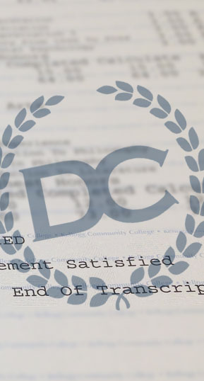 closeup of academic coursework on fake transcripts