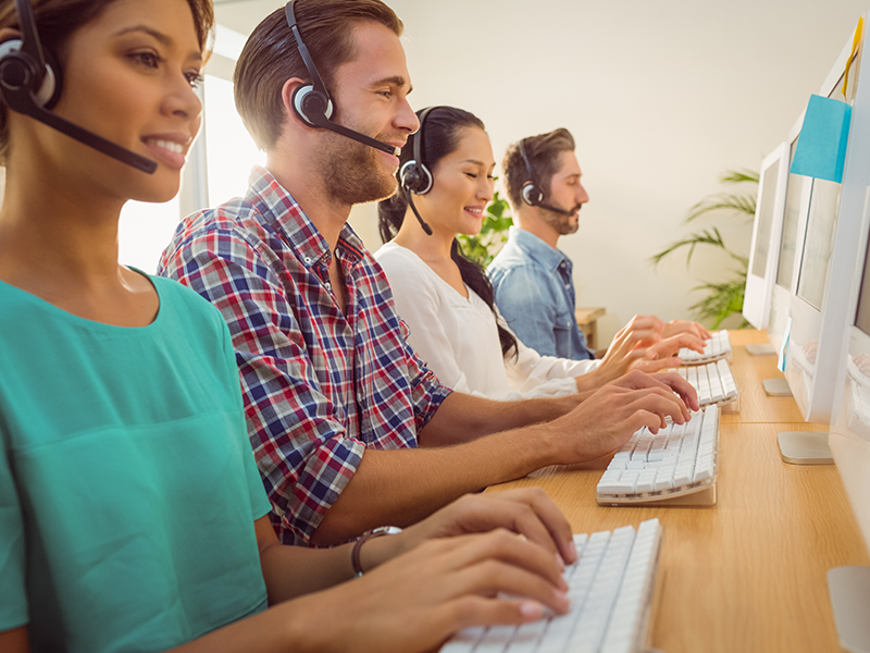 customer support agents in a call center taking calls from customers