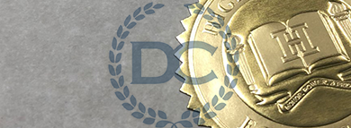 gold high school seal pressed into a foil and placed on a new diploma